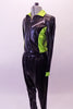 Two-piece hip-hop costume has shiny drop-crotch pants and a matching jacket. The jacket has zip front with neon green sides and collar with faux zipper painted accents at the front and back. Comes with shades. Side