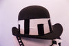 Black bowler hat with piano key design band