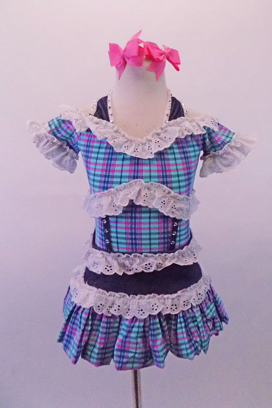 Plaid dress in shades of blue aqua and pink, has denim halter straps, waistband and crystalled faux boning accents. A wide white eyelet lace trim lines the off-shoulder top, pouffe sleeves, bust and waist. Comes with pink bow hair accessories. Front