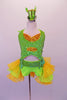 Two-piece costume is a pearl beaded sequined neon green halter half-top with gold sequined inlays. Matching green bottoms have a sequined waistband with money-symbol appliques at each hip. The open front bustle skirt is layers of green & yellow organza. Comes with matching wrist cuffs & mini green glitter top hat. Front