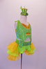 Two-piece costume is a pearl beaded sequined neon green halter half-top with gold sequined inlays. Matching green bottoms have a sequined waistband with money-symbol appliques at each hip. The open front bustle skirt is layers of green & yellow organza. Comes with matching wrist cuffs & mini green glitter top hat. Side