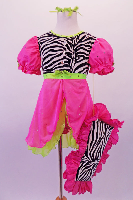 Nightdress themed costume is a hot pink and neon green with pouffe sleeves with scattered crystal accents and a zebra print torso with large crystal button accents. The costume has pink, crystalled bloomer pants to match the dress. Comes with green hair ribbons and a pink ruffled zebra pillow. Front