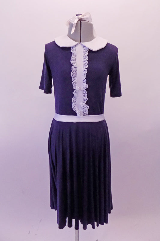 Navy blue vintage style dress has white Peter Pan collar and waistband the vertical front, lace ruffled accent band gives the costume its sweet innocence. Comes with a white ribbon hair accessory. Front