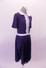 Navy blue vintage style dress has white Peta er Pan collar and waistband the vertical front, lace ruffled accent band gives the costume its sweet innocence. Comes with a white ribbon hair accessory. Side
