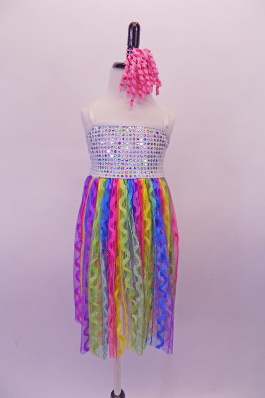 Empire waist camisole dress has a white sequin bodice and sheer knee-length rainbow coloured skirt with wave design. Comes with a curly pink hair accessory. Front