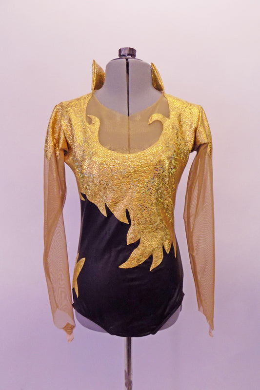 Black based leotard has gold front flame/scroll designed front torso & shoulders. The sleeves are a long nude mesh that attaches beneath the gold shoulders & high neck that opens at the front. The nude mesh also adorns the upper bust which keeps the design from curling and keeps it flat against the chest. Front