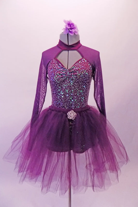 Purple short unitard with iridescent sequins has peek-a-boo front with purple mesh shoulders and long sleeves. The large open keyhole back creates a beautiful look. The long soft purple, open-front long tutu has a beautiful crystal rose brooch accent, Comes with a purple floral hair accessory. Front