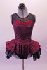 Burgundy sequined leotard dress has black sheer mesh front upper with sweetheart neckline. The sequined peplum sits on top of the open front layered black petticoat skirt, Comes with a black floral hair accessory. Front