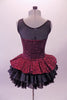 Burgundy sequined leotard dress has black sheer mesh front upper with sweetheart neckline. The sequined peplum sits on top of the open front layered black petticoat skirt, Comes with a black floral hair accessory. Back
