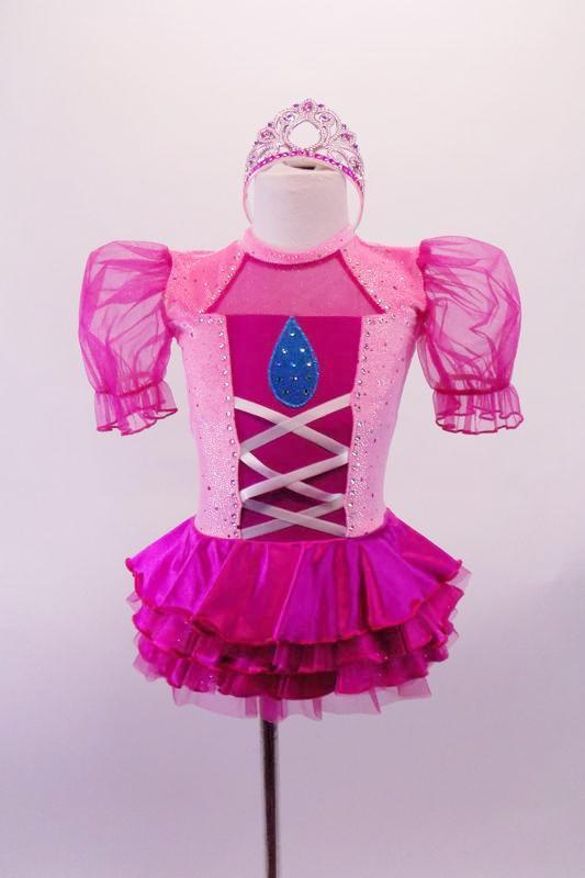 Pink and fuchsia dress has pink glitter velvet bodice with faux corset front and teardrop, pouffe organza fuchsia sleeves and ruffled sateen skirt. The keyhole back has a large white bow at the mid center of the back. Comes with a tiara hair accessory. Front