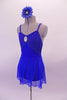 Royal blue leotard has a glittery bust the is accented with a large jewelled accent. The leotard is complemented by a matching sheer short sarong-type skirt. Comes with a jewelled blue floral accessory. Side