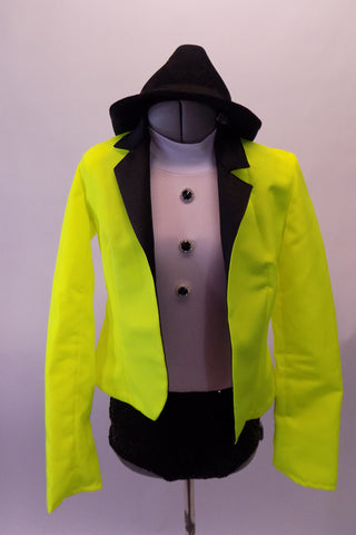 Two-piece costume has a black and white leotard base with black brief style bottom and high neck white, zip back sleeveless top with black jewelled button accents. The bright neon yellow blazer with black lapels is what really makes the bold statement. Comes with a black fedora. Front