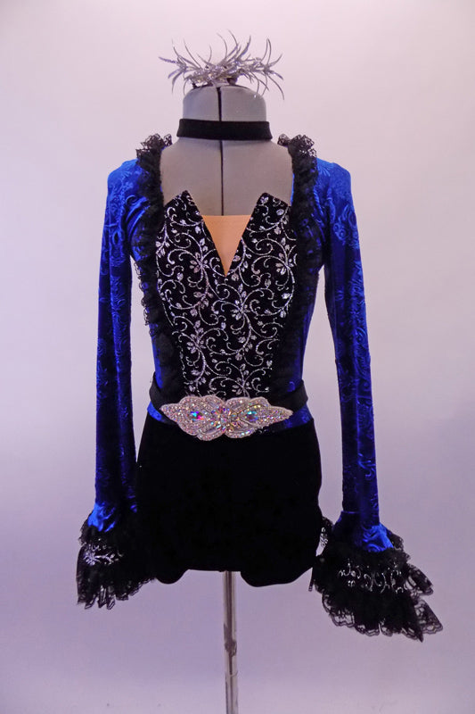 Short Gothic style unitard has a black bottom with a royal blue velvet brocade top & keyhole back. The front of the torso is black & silver print with a peaked bodice edged with black lace ruffle. The long trumpet sleeves have layered black lace.  Comes with black  appliqued belt, velvet choker & silver hair accessory. Front