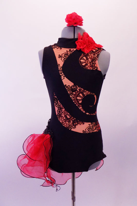 Black leotard has a black lace print on nude, inlaid in a swirled pattern across the torso & open back. The left side of the neck has a red ruffle.  A double layered red curly hemmed side bustle sits along the right hip & back accented with black beaded appliques. Comes red with a red floral hair accessory. Front