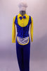 3-piece costume has a bright yellow button front collared shirt with attached blue bow tie. A blue pinstripe black polka dot vest that gathers at the back sits over the shirt & compliments the blue stretch fabric trousers with an attached white mini apron. Comes with white plush chef hat accessory with elastic. Front