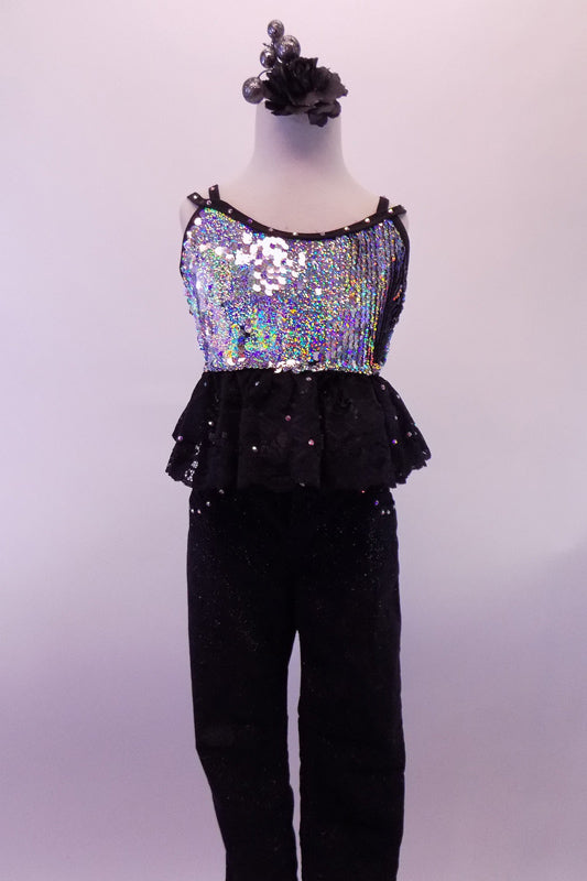 Glittery black jeans with crystal accents at the pockets, accompany a silver sequined half-top with wide double layered, crystalled, black lace ruffle below the bustline. The banding & double back straps are lined with crystals. Comes with long white crystalled gauntlets & hair accessory. Front