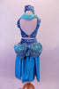 Turquoise 2-piece Arabian themed costumes has a fully sequined low-back, tank style half-top. The bottom is a brief with sequined bubble pouffe full bustle with long open front, knee length, turquoise taffeta skirt. The edge of the skirt is trimmed with silver lace that matches the silver & blue waistband & genie hat. Back