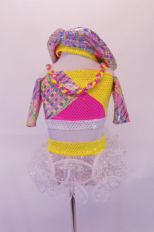 Two-piece pink yellow and silver paid patchwork half-top has ¾ cold shoulder sleeves with braided shoulder straps that extend into a necklace accent at the front. The bottom is a matching plaid patchwork brief with yellow waistband and white glittery curly hem, layered ruffle skirt. Comes with plaid tam hat. Front