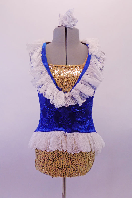 Three-piece costume has a gold half top and briefs which sit below a blue velvet brocade tunic. The tunic is a V-neck with white lace ruffle at the neckline and hip and floral bow accent at back. Comes with lace ruffled velvet gauntlets. Front