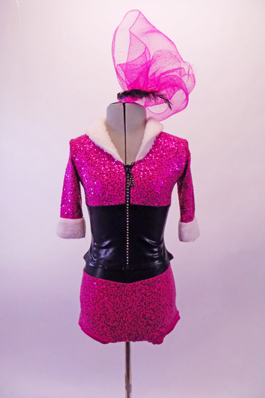 Two-piece costume has a sequined hot pink brief-style short and matching zip-front top. The top is a crystalled zipper, black leatherette midriff and white fur collar and cuffs. Comes with a large hair accessory. Front