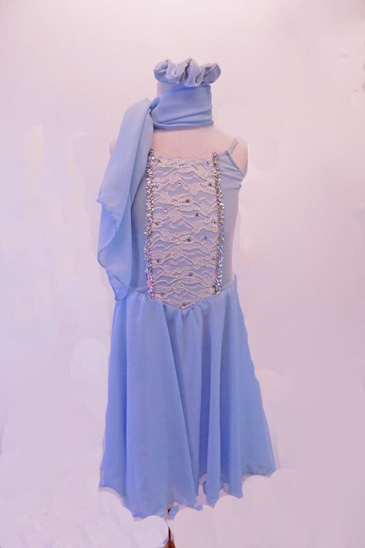 Pale blue chiffon dress has white lace front scattered with crystals and edged with silver braiding. The back is connected by a set of criss-cross straps lined with crystals. Comes with a chiffon scarf and matching hair accessory. Front
