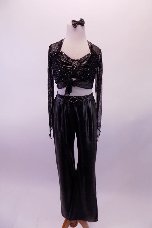 Black leatherette pants with crystal buckle has a matching bra with crystal accents. The black sheer glitter shrug ties at the front over the bra. Comes with leather bow hair accessory. Front