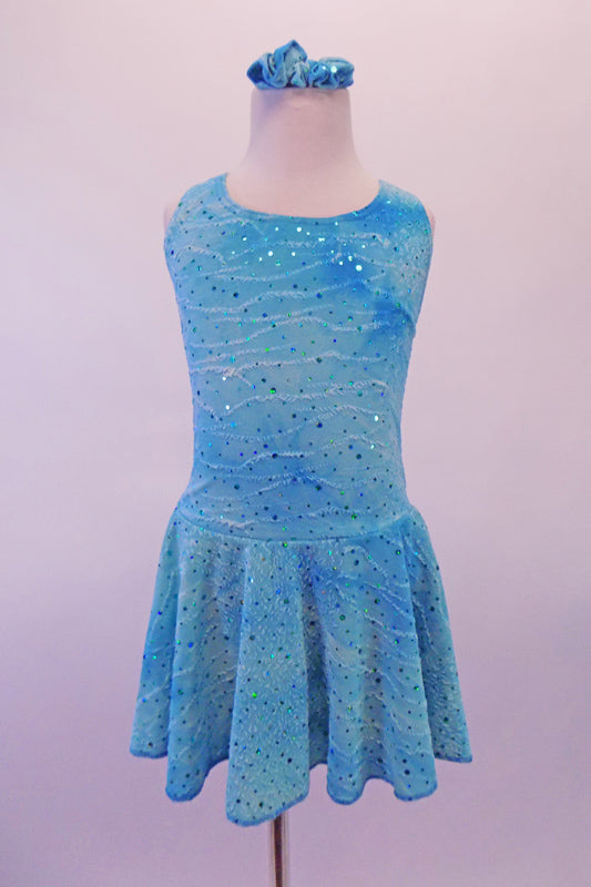 Dress has marbled and crackled look in shades of aqua blue crinkle chiffon with scattered glitter throughout. The wide cross-back straps and built-in brief keep the dress in place. Comes with matching hair accessory. Front