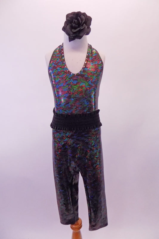 V-neck halter-neck unitard is an iridescent black speckle print with capri-length pant and open back. Comes with gathered wide, black, elastic belt and black floral hair accessory. Front