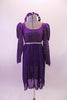 Purple medieval style dress has a silver diamond pattern on the velvet bodice and pouffe long sleeves. The purple knee length cotton skirt falls straight Comes with velvet wreath hair accessory. Front