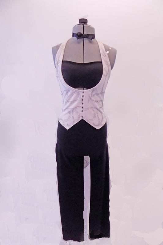 Black pants are accompanied by a black bandeau top that sits beneath a white velvet swirled vest tailcoat with crystalled buttons. Comes with a black bow tie that ties around the neck. Front