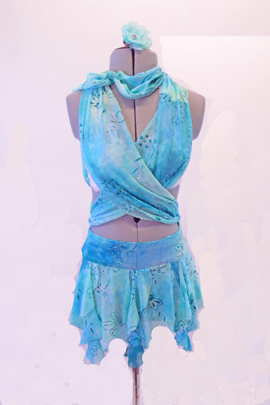 Light blue marble costume with glitter floral design is the base of this 3-piece costume. The short kerchief hemline skirt has a wide waistband with loops. A wide shawl drapes behind the neck & crosses over the front torso covering the white lace bra, then loops through the waist, crossing at back & ties at the neck.  Front