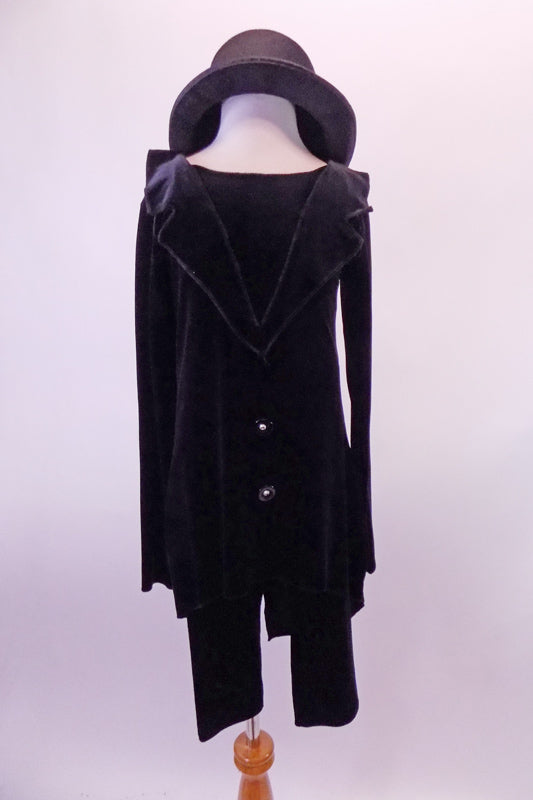 Quirky black velvet tunic style tailcoat has a faux collar and large front buttons. The black velvet ¾ length pants and black top hat create a fun yet creepy feel. Front