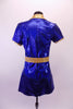 Royal blue shimmery tunic style short V-neck dress with side slits, has a gold lapel collar and matching gold belt. Comes with matching brief and hair accessory. Back