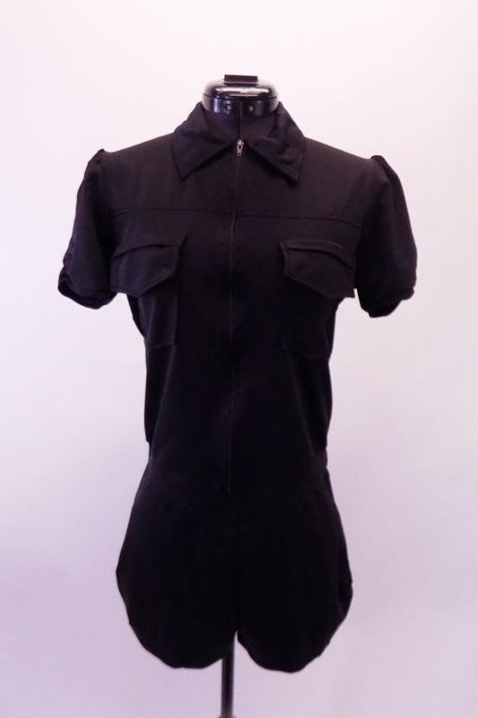 Black short unitard with zip-front and lapelled collar has a black bra top that goes underneath. The costume can be worn zipped half-way or fully. Front