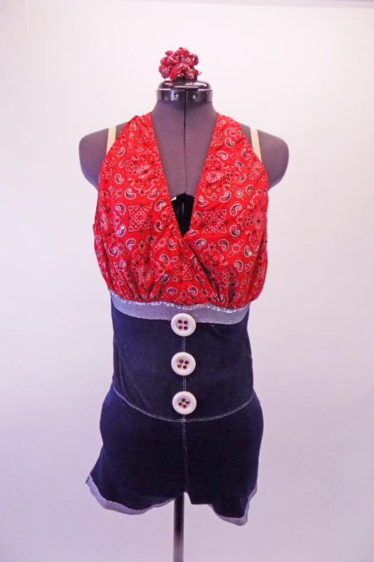 Red country-paisley patterned halter tie-neck unitard has an attached high waisted denim-like short that starts from just below the bustline and has large front button accents. The back pockets are lined with red crystals. Nude shoulder straps are attached for better support. Comes with matching hair accessory.  Front