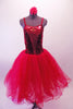 Crimson red romantic tutu has long tulle skirt with a crushed velvet bodice. The front center of the torso is red sequin with a large red jewel brooch accent. The back has a nude panel with faux corset ties. Comes with a floral hair accessory. Front