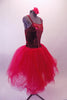 Crimson red romantic tutu has long tulle skirt with a crushed velvet bodice. The front center of the torso is red sequin with a large red jewel brooch accent. The back has a nude panel with faux corset ties. Comes with a floral hair accessory. Side