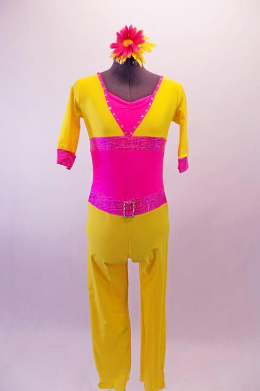Bright yellow and neon pink ¾ sleeved unitard with a bright neon pink wide waistband. The pink flapped back pockets accent the yellow pants. Crystals line the collar and match the crystal belt buckle. Comes with a floral hair accessory. Front