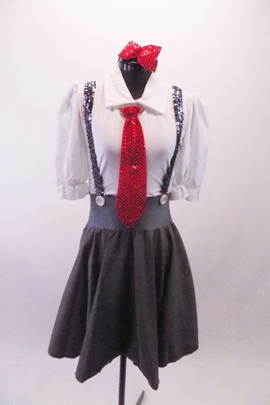 Two-piece schoolgirl themed costume has a grey cotton/tweed knee-length circle skirt with wide waistband, button details and silver sequined suspender straps that cross at back. The white pouffe sleeved leotard has an attached shirt-like collar and keyhole back. Comes with a red sequined hair bow and necktie. Front
