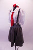 Two-piece schoolgirl themed costume has a grey cotton/tweed knee-length circle skirt with wide waistband, button details and silver sequined suspender straps that cross at back. The white pouffe sleeved leotard has an attached shirt-like collar and keyhole back. Comes with a red sequined hair bow and necktie. Side