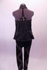 Bad girl style black studded zip front halter vest has a gathered elastic back that flares out slightly at the hips. Comes with black leggings with a zig-zag studded design pattern on the leg. Back