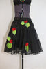 Black knee length layered crinoline skirt with grommets and 3D roses /leaves. Comes with a black bra  that has lace detailing and roses/leaves.bottom zoom
