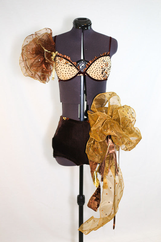 Caramel bra, brown velvet piping and flowers. Gold organza pouf on right shoulder. Shorts are brown velvet with crystal detail, large bow/pouf on the right hip, front