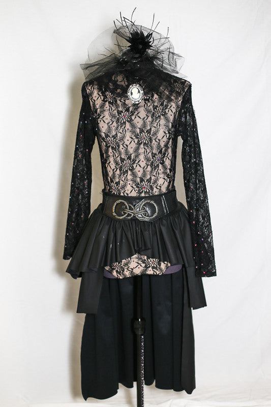 Long sleeved, black, open backed lace bodysuit with crystals throughout. Attached high tulle collar with vintage lace and a cameo & leathery, ruffled skirt, front