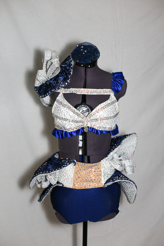 Double layered blue/silver wave skirt, hugs the hips/waist, by Velcro band.Bra has blue satin ruffles,covered with AB crystals and shoulder piece mimics skirt, front