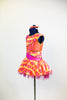 Dress has a wave of orange and yellow with white/pink flowers with crystal centers, side