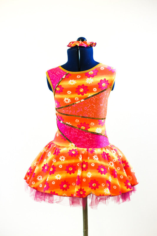 Dress has a wave of orange and yellow with white/pink flowers with crystal centers, front