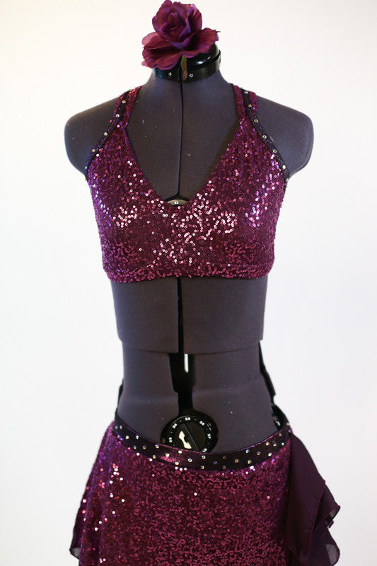 Two piece purple sequinned costume with chiffon ruffle inserts front.