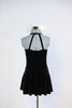 Black stretch velvet dress with attached panty has an ivory ruffled bib, black button and bow-tie accent. Comes with large, ivory bow, hair accessory. Back