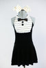 Black stretch velvet dress with attached panty has an ivory ruffled bib, black button and bow-tie accent. Comes with large, ivory bow, hair accessory. Front zoom